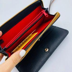 Dooney & Bourke Bags - Dooney & Bourke Zip Around Phone Wristlet